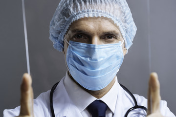 Portrait of a smart doctor looking through medical glass
