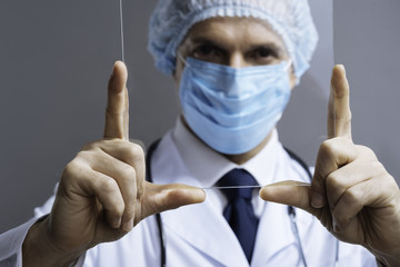 Close up of attractive doctor looking through medical glass