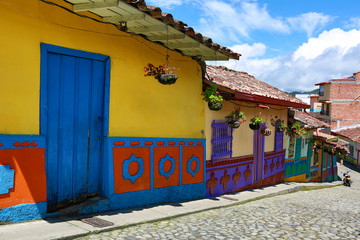 brightly coloured houses along cobblestone streets of Guatape Colombia