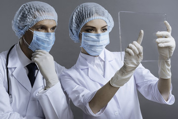 Man and woman using medical glass