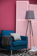 Blue armchair in stylish interior
