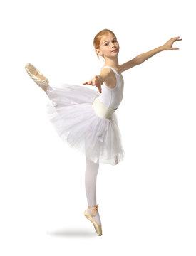 Young beautiful ballerina dancer posing on light background