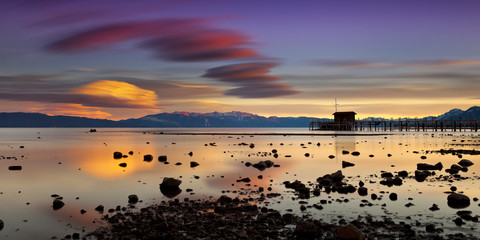 Pier in Tahoe City, California in Lake Tahoe at sunset with vivid clouds