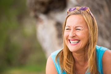 Joyful smiling mature woman outdoor