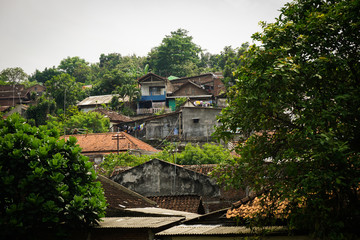 Slums on a mountain with green view photo taken in Semarang Indonesia