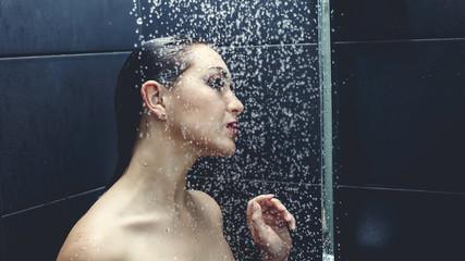 Beautiful sexy  young woman washing body in a shower