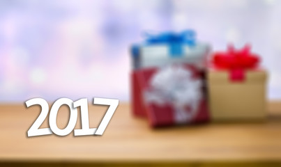 2017 Happy New Year Holiday on blur bokeh and box background wit