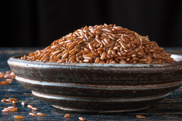 Bhutanese red rice in pottery bowl