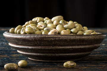 Roasted and salted edamame in a pottery bowl