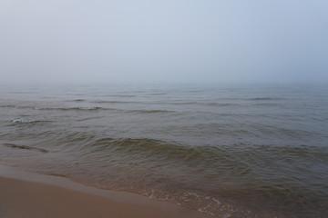 Fog over big lake on cold November morning