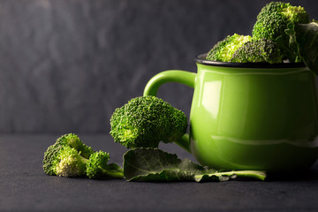 still life with fresh green broccoli in ceramic cup