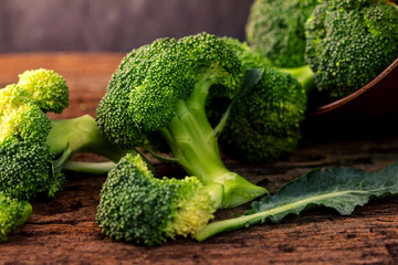 selective focus  fresh green broccoli on wooden