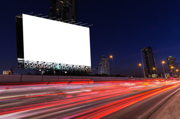 Blank billboard on light trails, street and urban in the twilight, night - can advertisement for display or montage products or business.