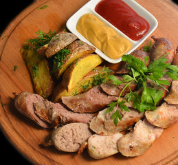 Meat sausages on a wooden Board
