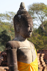 above body part of sitting ancient buddha statue, one of the most important and visiting historical landmark at ayutthaya, Thailand for tourism
