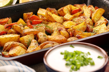 Baked potatoes with herbs and white dip