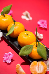 Chinese new year's decoration. Mandarin orange on red background