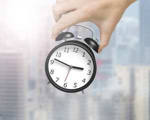 Woman hand holding alarm