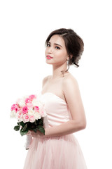 Happy bride with a bouquet of roses. Isolated on white backgroun