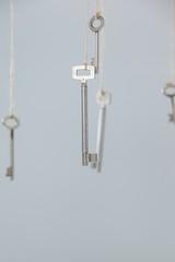 Keys hanging on strings