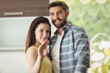 Couple holding keys in their new house