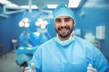 Portrait of male surgeon smiling in operation theater