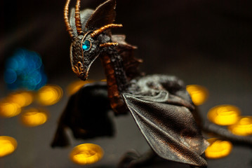 black leather Dragon Figure with gold coins