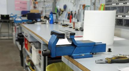 Blacksmith vise in a large machine shop