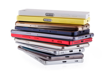 Pile of mobile phone. Heap of the different smartphones isolated