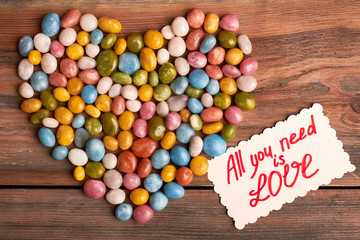 All you need is love. Colorful candy sea pebbles. Sweet romantic surprise.