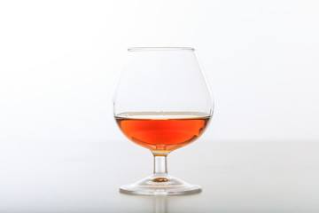 Cognac glass on white background