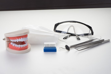 Tool of professional dentist on a white background