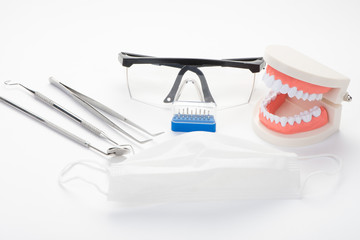 Modern dental office tools on a white background