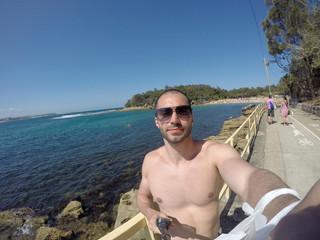 Man taking a selfie in Manly Beach, Sydney, Australia