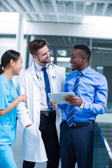 Nurse and doctor having a discussion with businessman