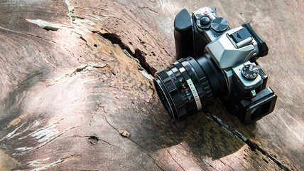 camera on wooden background