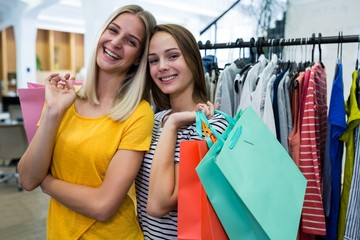Women doing shopping at clothes store
