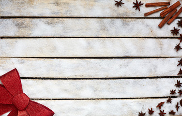 Festive red bow on the white wooden table. Holiday and gift concept. picture with free space for text