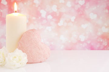 Valentine's heart and candle with a bright background