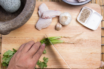 Chef cutting coriander with knife