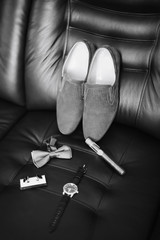 wedding rings on leather background