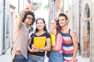 Group of multiracial students taking a selfie in the city.