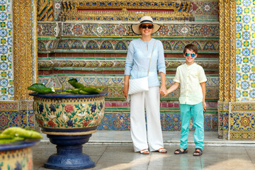 Young mother and her little son walking in Grand Palace, Bangkok