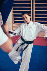 Girl on Tae kwon do training with trainer