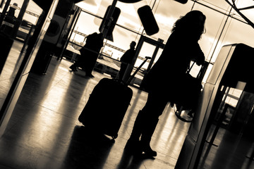 people at the airport sepia colored