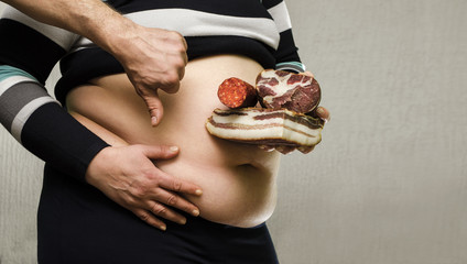 Unhealthy eating concept, obese woman holding greasy food