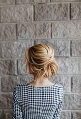 Blonde Woman hairdo french twist, rear view