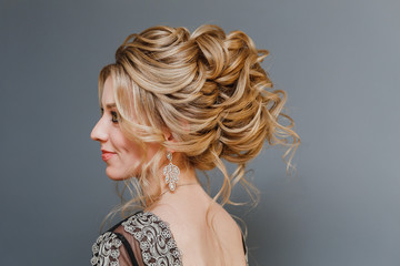 Model blonde Woman with perfect hairstyle and creative hair-dress, back view
