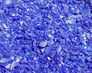 Crushed blue glass peices background. Horizontal.