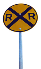Isolated railroad crossing sign. Vertical.